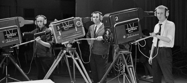 TAMVISION'S CAMERA OPERATORS KAUNO PELTOLA, LASSE KOSKINEN AND TUOMO KURIKKA POSE NEXT TO TELEVISION CAMERAS AT FRENCKELL'S STUDIO IN TAMPERE, 1.2.1965